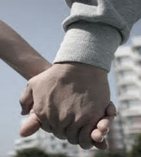Man holding ladyboys hand
